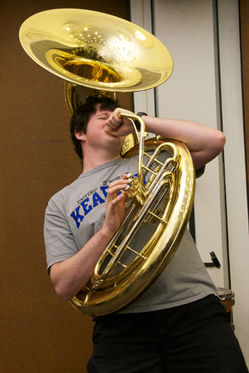Persson brings a 'great sense of humor' to the band as you can see in this picture. He makes band fun for others by bringing his sense of humor along with him to practices and performances. Persson is known as 'Tuba' to most and is proud to be in the band. Photo by Hanna Jorgensen