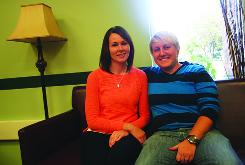 Alicia Behn (left) and Laura McDiarmid, both of Kearney and UNK graduates, talk about their relationship in The Living Room in the Nebraskan Student Union. Behn and McDiarmid have dealt with many struggles as a same-sex couple, including the fight for marriage recognition and legal citizenship. Photo by Austin Koeller