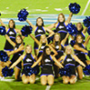 The UNK Cheerleaders pose at the end of their performance at the Lopers Under the Lights event on Saturday.