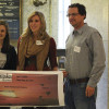 Photos by Austin Koeller Kelsey Bonta (left) and Mallory Placek present a check for $800 to Shane Wegner of Junior Achievement as part of the education focus group. The focus group was one of four that split $2500 among local non-profit organizations.
