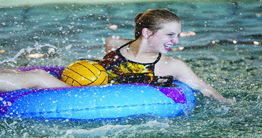 Jordanna Glock, a Molecular Biology student here at UNK, is splashing around while competing in co-rec finals of Water Polo intramurals. Jordanna is originally from Shelby, Nebraska.