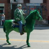 Courtesy The renowned green horse makes his anticipated appearance at the annual St. Patrick's Day parade in O'Neill. His rider is just as festive, decked out in all green.