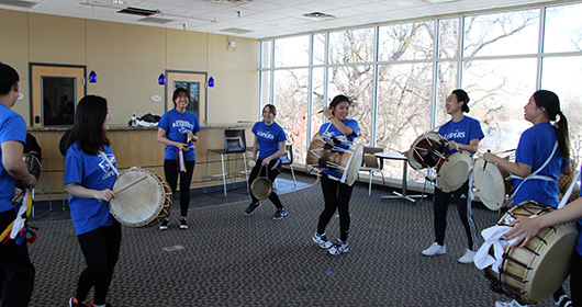Members of Samul Nori Ensemble Kearney (SNEK) practice for the upcoming performance in the Nester View.