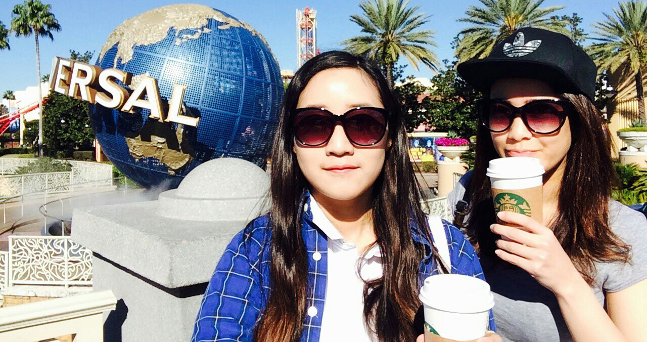 International students Youngjae Park (left), from Seoul, South Korea, and Yasumin Nishioku (right), from Osaka, Japan, travel Universal Studio in Orlando during spring break.