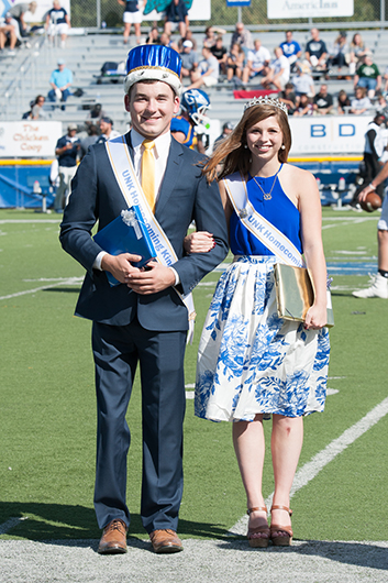 UNK Homecoming queen Lainey Russell of Kearney and Luke Grossnicklaus of Aurora take the field.