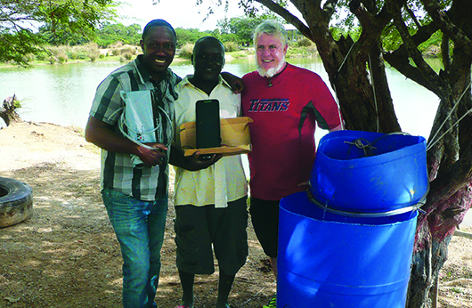 Courtesy Bickford, right, with local pastor in charge of one of the programs sites (middle) and a man named Threese, (left) who oversees another site and started one school currently under construction by university's program.