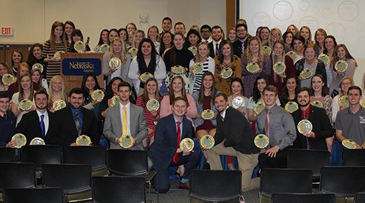Photos by Cody Moslander Greek members who achieved a 4.0 GPA in the fall semester of 2016 show off their cookies.