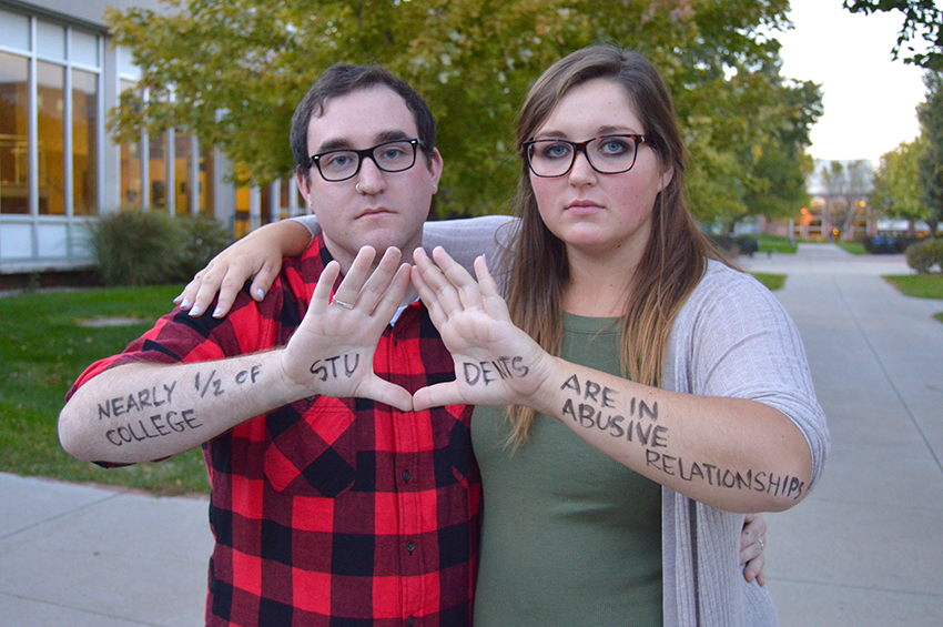 Photo by Rachel Arehart Robert Alberts participates in a Women's Center social media promotion with coworker Bailey Bond. Student leaders on campus were photographed with powerful messages written on their arms and hands. Alberts is the Women's Center graduate intern. They work primarily with LGBTQIA issues and finding undergraduate help for the office. Alberts will remain as a part of the Women's Center team until May.