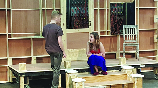 Brenden Zwiebe, a sophomore theatre major from Lincoln, confronts freshman theatre major Megan Hayhurst, Scottsbluff, during a front porch scene. Zwiebel plays Jake, an abusive plantation worker, while Hayhurst plays Flora, his battered wife.