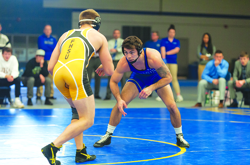 Photo by Todd Rundstrom Senior Destin McCauley eyes his opponet during a recent match at Cushing Colesium. The Physical Education K-6 major from North Sioux City, IA has found success in wrestling at many levels, including here at UNK.